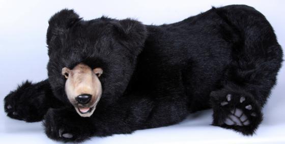 Мягкая игрушка медведь Hansa 4982 90 см черный искусственный мех лежащий hansa медведь полярный спящий 4922 мягкая игрушка