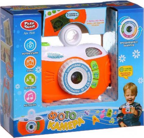 Интерактивная игрушка China Bright Фотоаппарат на батарейках (обучение, игры, эффекты, 4 функции, вращ.объектив, звук в/к) от 3 лет оранжевый 7540 игрушка china bright фотоаппарат 7540